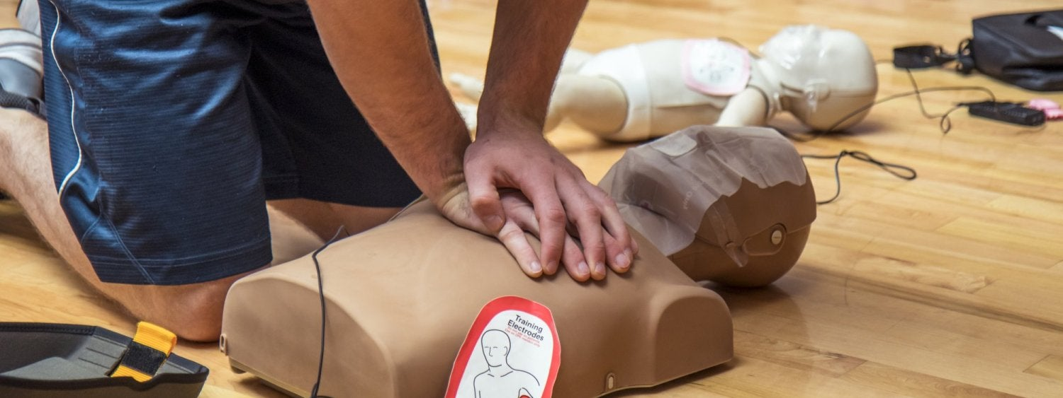 CPR compressions on a dummy