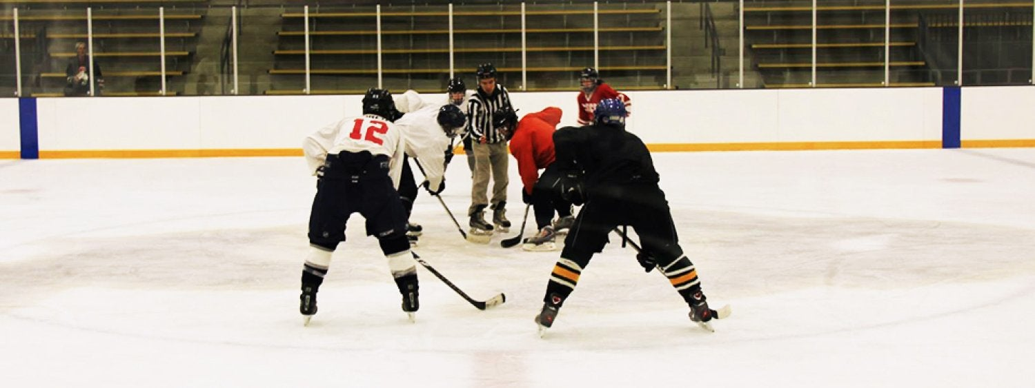 Hockey being played on ice rink