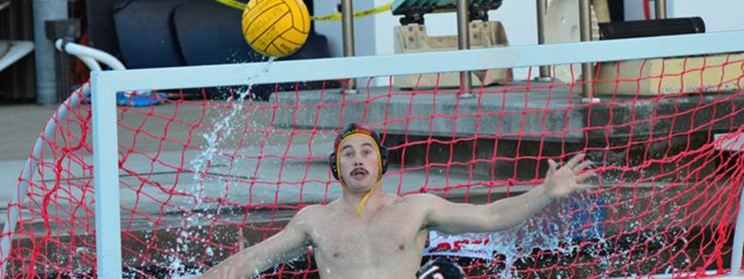 Water polo player blocking goal