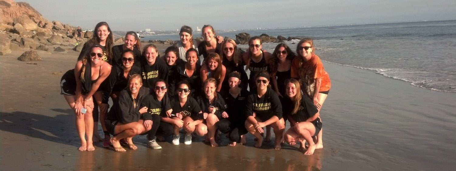 Lacrosse women's team on the beach