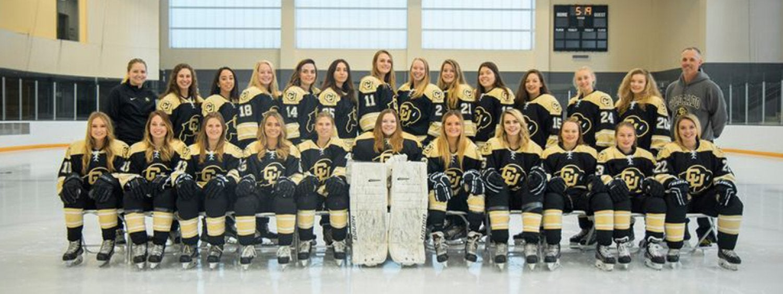 the 2019-2020 women's hockey team posing on the ice