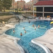 People playing water volleyball in the buff pool