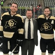 CU Buffs hockey players and coach