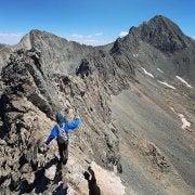 student on a mountain peak