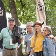 CU Buffs posing for a picture with their families.