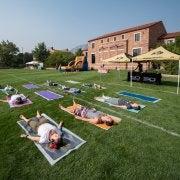 Students enjoying a yoga class on Farrand Field
