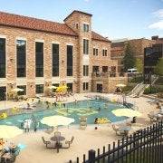members lounging at the outdoor Buff Pool