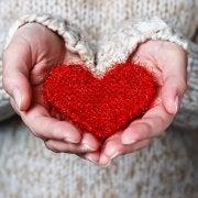 Woman holding a plush heart