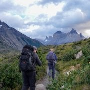 two people hiking through a valley in Patagonia