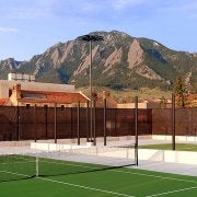 Rooftop tennis courts with flat irons