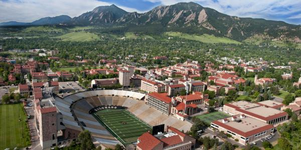 Aerial view of CU Boulder campus with Folsom Field in the foreground.