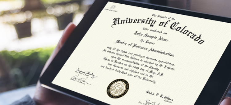 Close-up of a tablet displaying a sample University of Colorado CeDiploma.