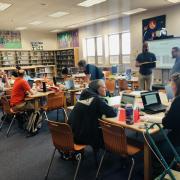 Photo of iSAT researchers leading a DPS teacher workshop.