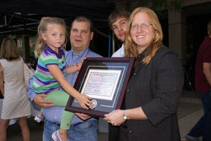 Kristi Anseth and family with her award
