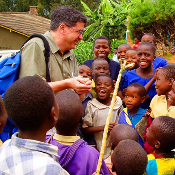 Professor Bernard Amadei with youth