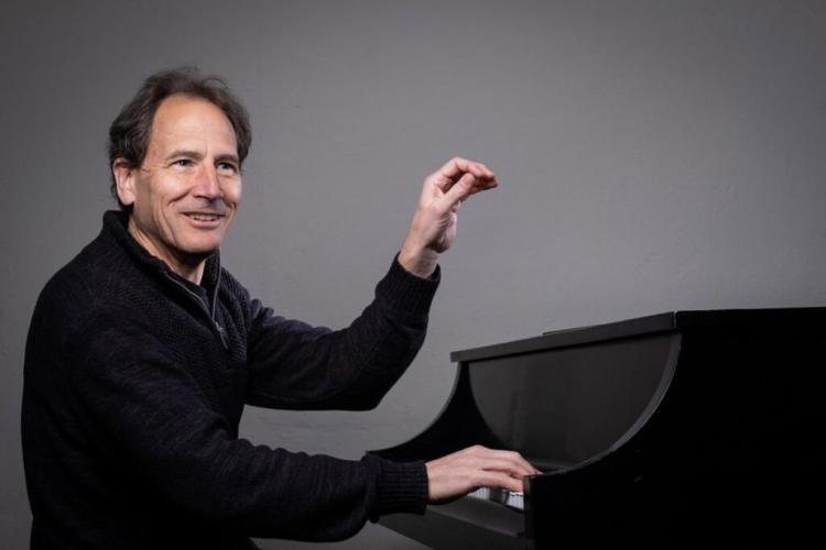 Professor David Korevaar at the piano