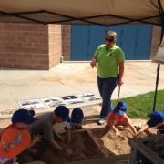 Jane at Friday Fun Day - Pueblo County Fair 2016 showing children how to excavate 3D printed artifacts and match them to original photos. / Jane en la feria del municipio de Pueblo, mostrando a niños como excavar objectos impresos en tres dimensiones y emparejarlos con sus fotos originales.