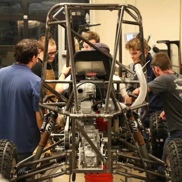 Team assembling the frame