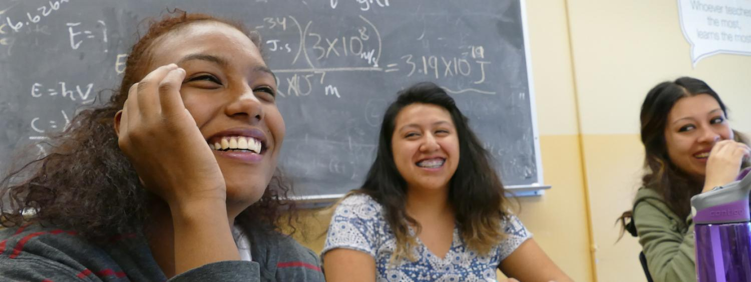 students laughing together in class