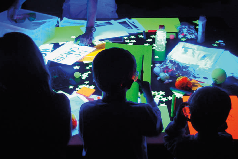Kids enjoying the SBO ultraviolet room