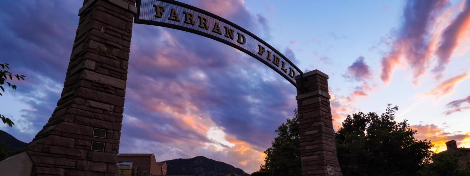 farrand field sign with sunset