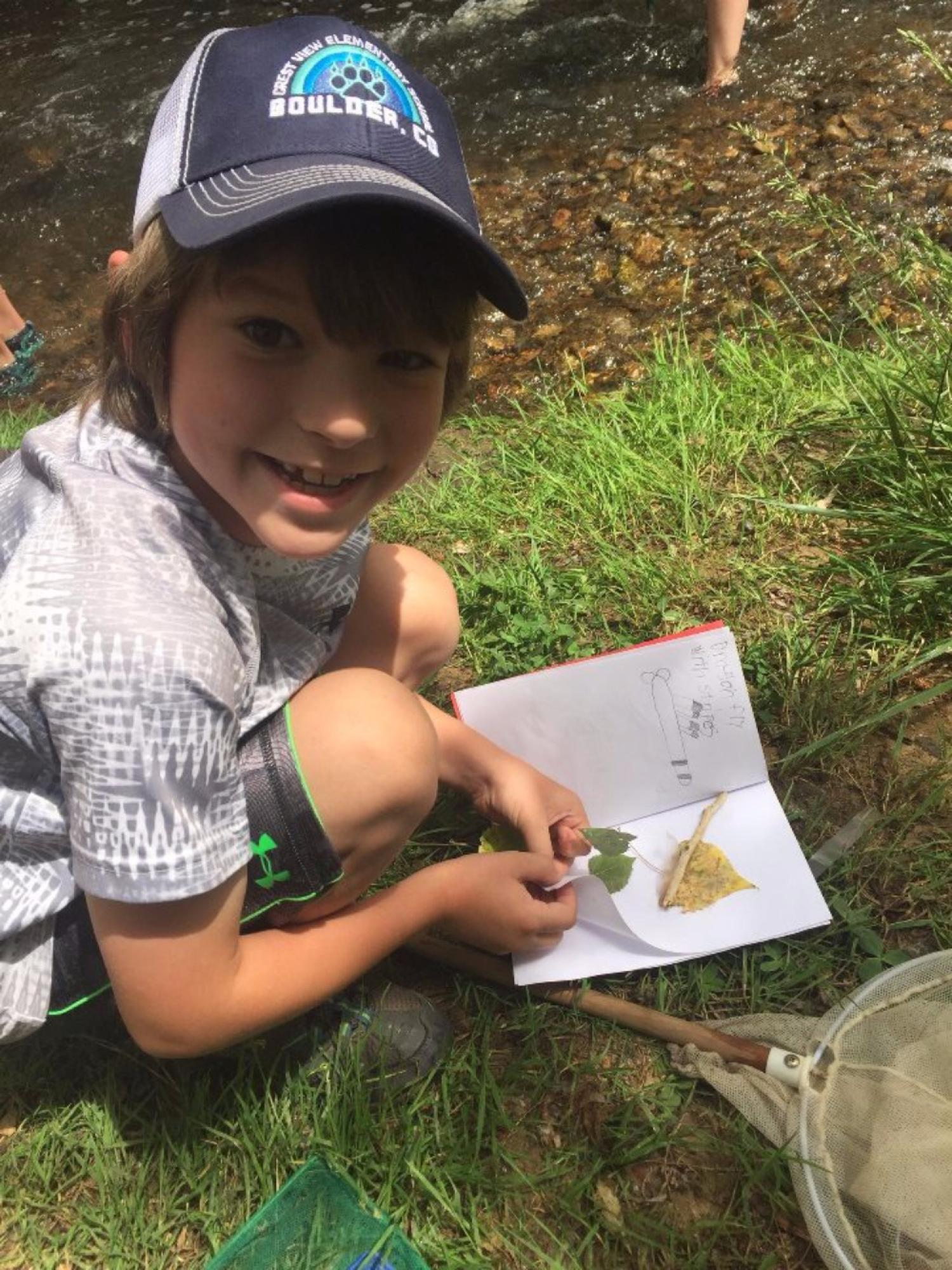 boy smiling with his nature book