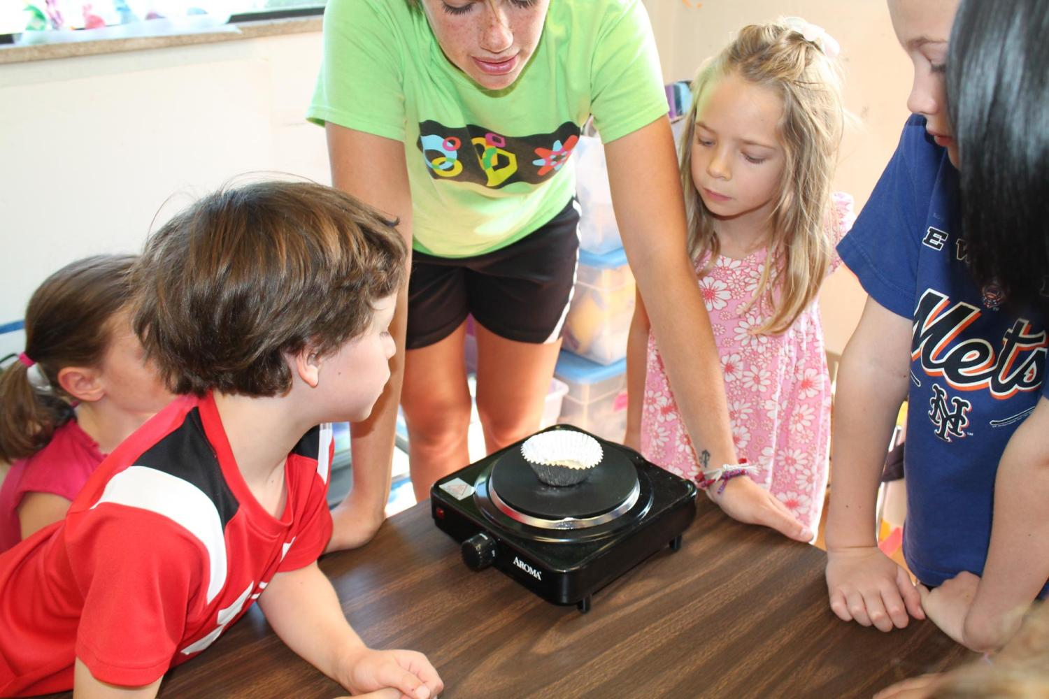 children watching experiment on a hotplate