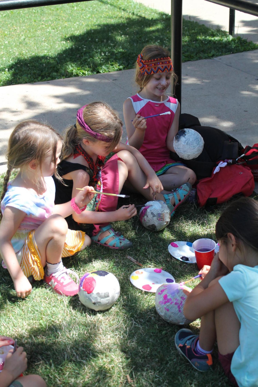 kids gathered doing Papier-mâché