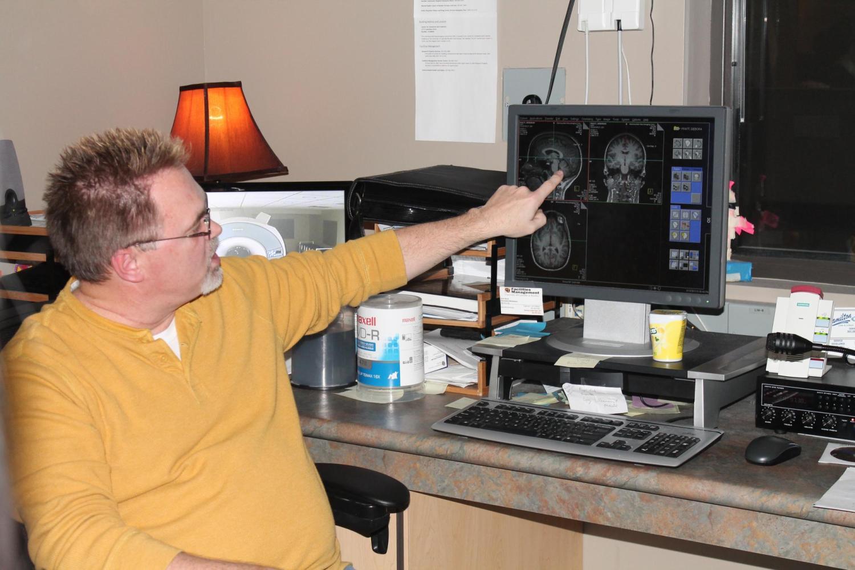 teacher pointing at brain scan