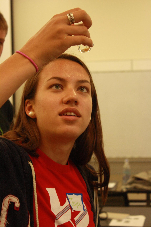 girl looking at specimen