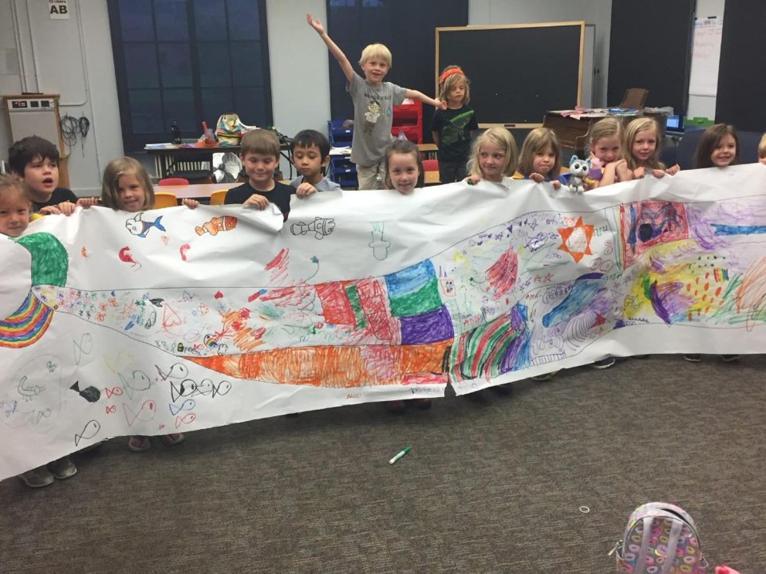 kids holding up their rainbow whale creation