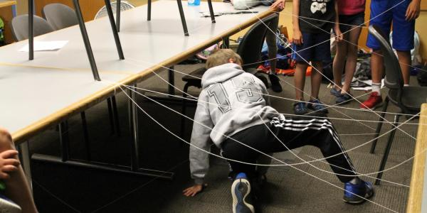 student navigating through a maze of string