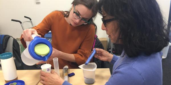 2 teachers performing an experiment in the STOBE STEM workshop.