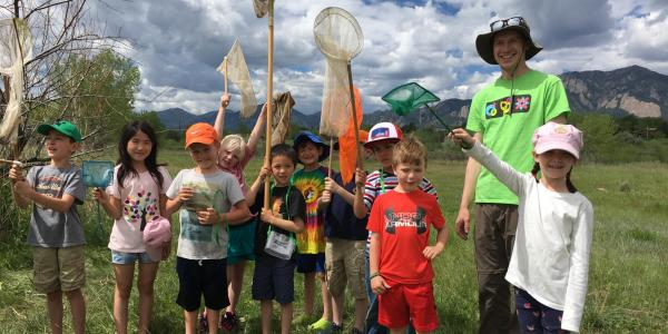 kids with nature equipment outdoors