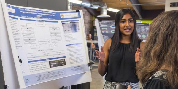 girl presenting her research project