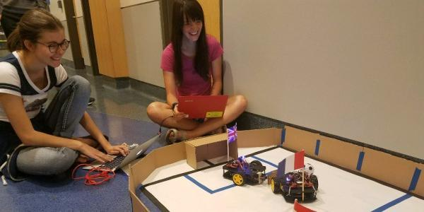 girls programming a robot