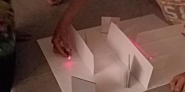 boy doing a laser maze