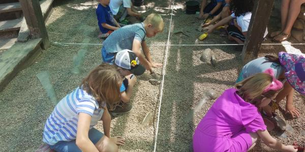 kids excavating rocks
