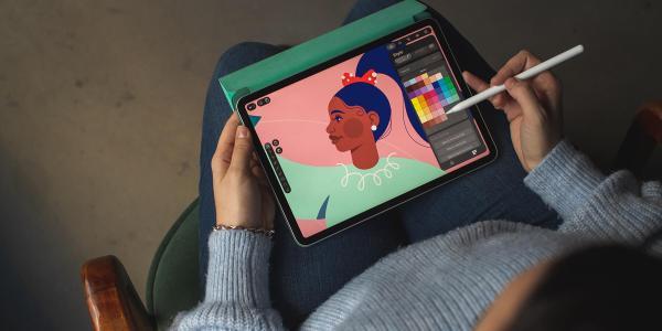 kid designing art on ipad