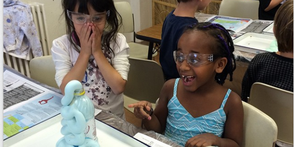2 students reacting to an experiment.