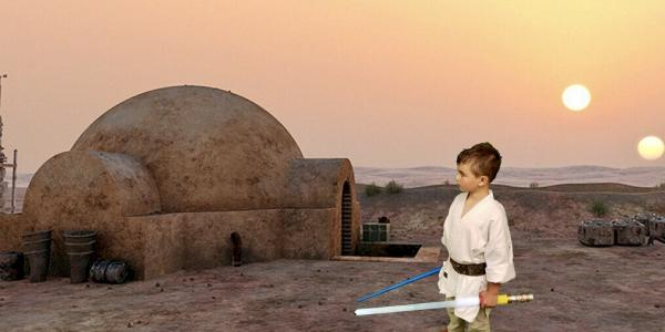 boy in from of Star Wars green screen