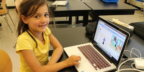 girl and her Scratch program