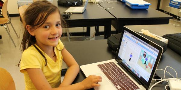 girl smiling at computer