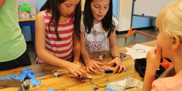 2 girls playing with makey makeys