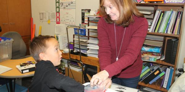 teacher and student doing an experiment