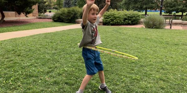 boy testing hula hoop