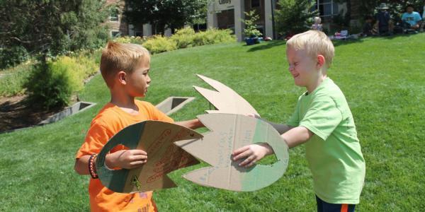 boys with dinosaur wings