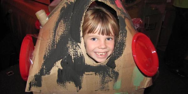 child inside of handmade rocket