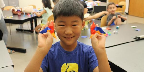 boy holding origami