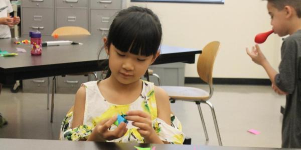 girl doing origami